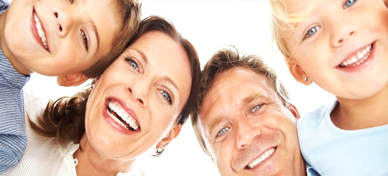 Picture of family smiling with clean white teeth